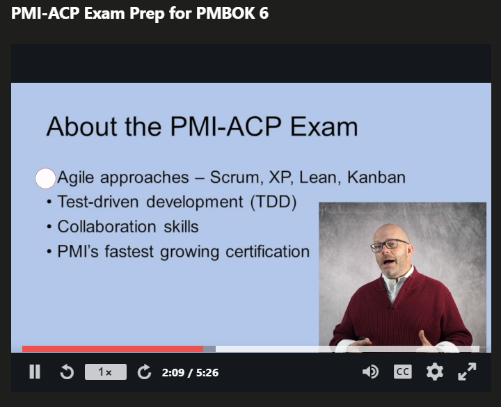 Picture of Joseph's Udemy PMI-ACP PDUs course with a slide showing in the background and him talking.