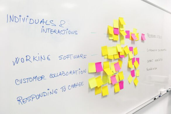 whiteboard-with-stickies-on-it-to-showcase-agile