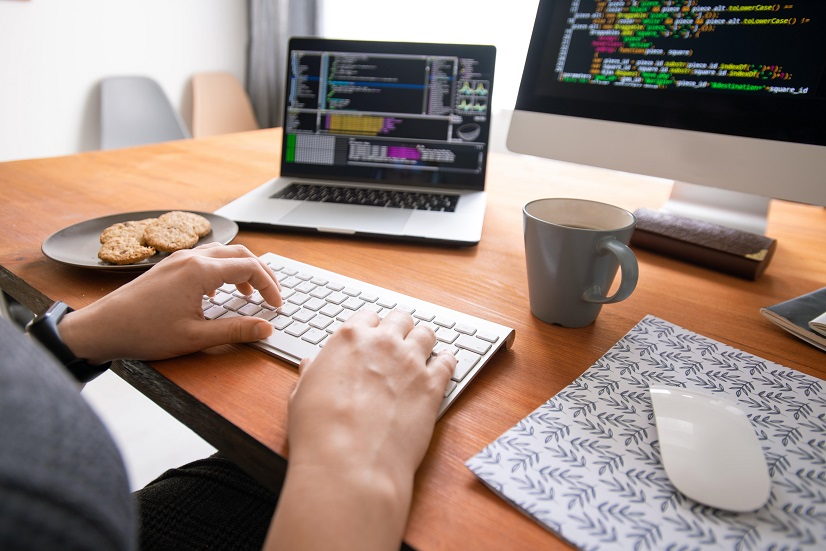 A coder on his computer with code on the screen
